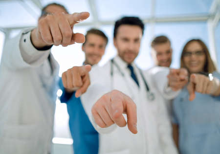 Doctors pointing with the index finger at the viewer. Фото со стока