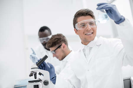 group of young scientists conduct laboratory studies