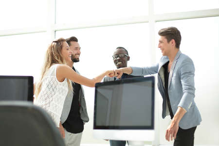 friendly business team in a modern office