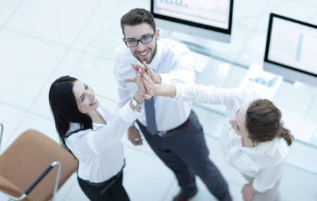successful business team giving each other a high five . 版權商用圖片