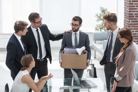business team and frustrated employee with personal things Stock Photo