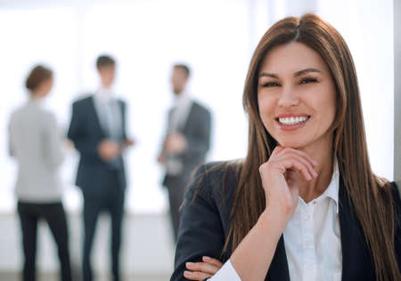smiling business woman on blurred office background