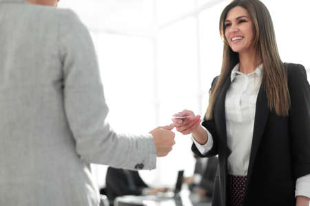 close up.business woman giving business card to a business partner