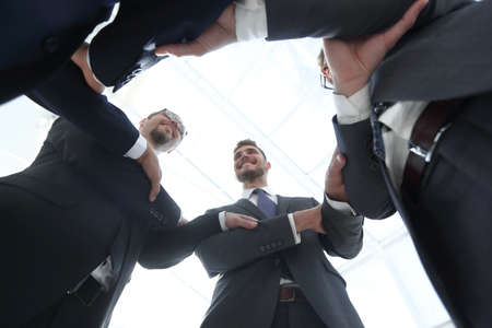 bottom view.smiling business people form a circle