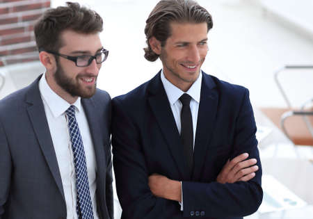 confident businessmen standing together in office Stock Photo