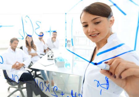 view through the transparent Board. female biochemist analyzing information.