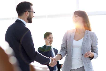 handshake between colleagues in the workplace