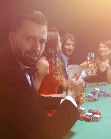 Handsome man playing in casino Stok Fotoğraf