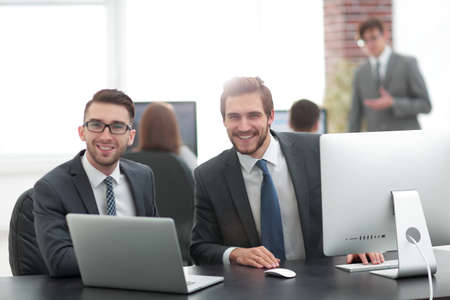 Business partners discuss prospects of the agreement Stock Photo