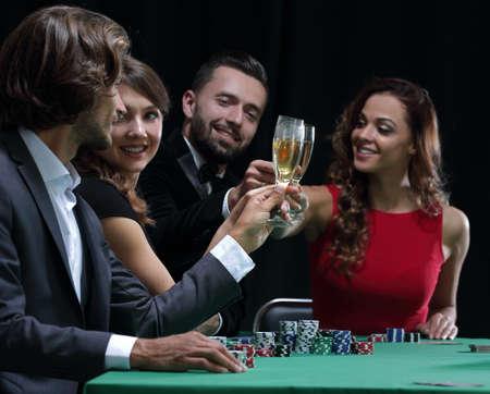 friends drinking and celebrating a gambling night Reklamní fotografie