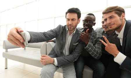 business team takes selfies in the lobby of the business center