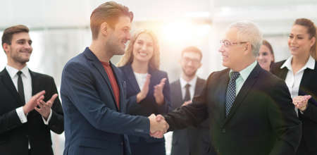 handshake of business partners after a business meeting in the office