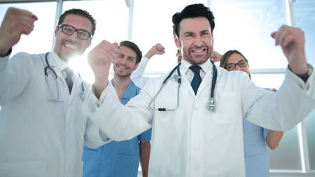 a victory sign of a team of doctors in white coats Banque d'images