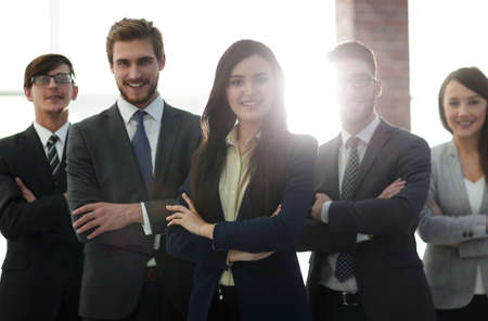 Attractive young business owner in office, folded hands in fron