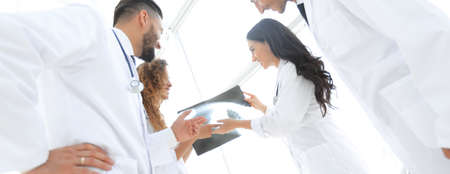 group of doctors discussing an x-ray Stok Fotoğraf