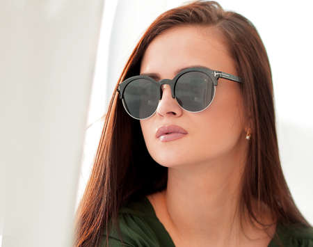 fashionable young woman in dark glasses
