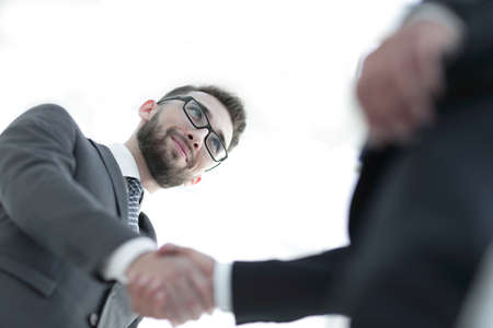 Successful business people handshaking after good deal. Stock Photo