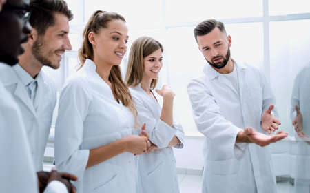 Group of young clinicians experimentation in research laboratory Stock Photo