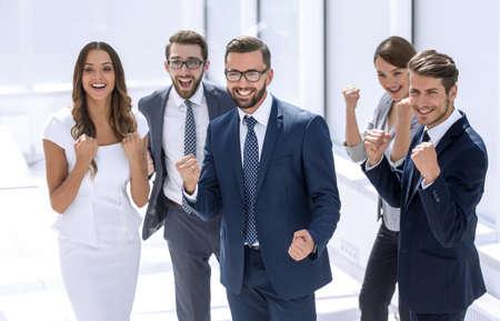 happy business team standing in office. Reklamní fotografie