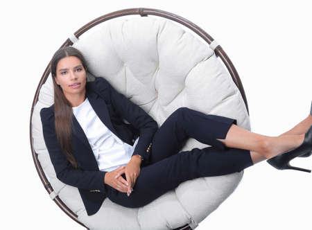 business woman thinking,sitting in a round chair Imagens