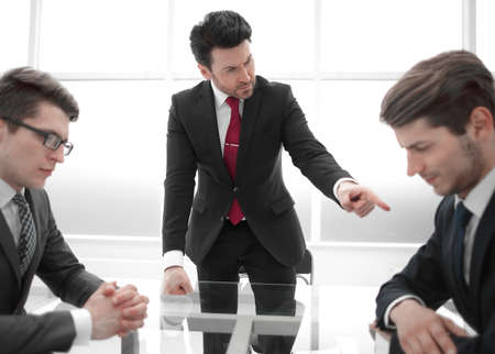 strict boss scolds unprofessional employee at a working meeting