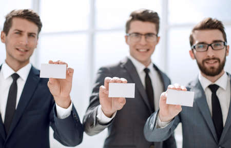 young business people showing their business card