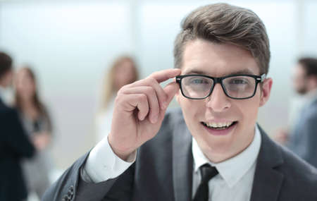 smiling young businessman looking at you attentively Standard-Bild