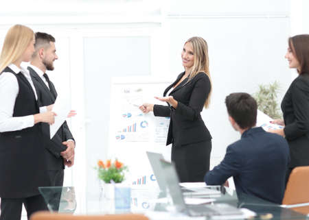 business woman pointing a pointer on a flipchart