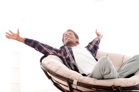 stylish guy stretching in a comfortable chair Imagens