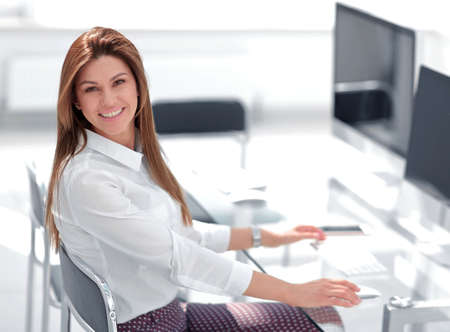 smiling business woman in the workplace.