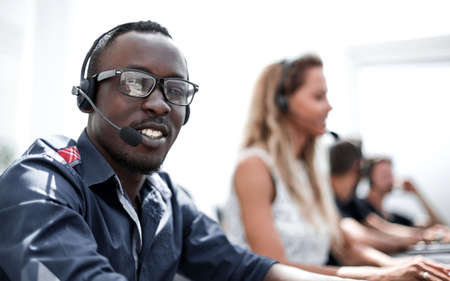 call center employee on the background of colleagues