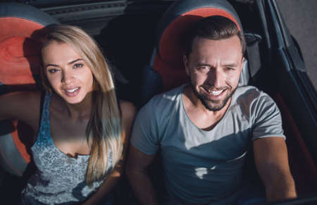 young couple travelling by car in the evening