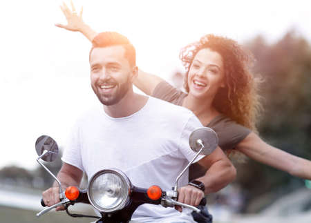 Happy couple driving scooter excited on summer holidays vacation Banco de Imagens