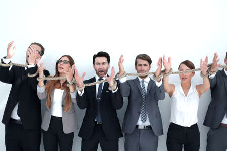 scared group of business people tied with a rope. Stock Photo