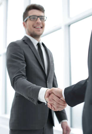 close up.businessman shaking hands with his partner