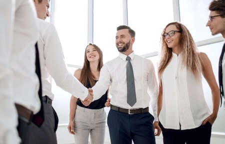 business people shake hands standing in the office