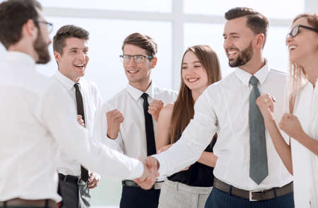 happy business team looking for a handshake of business partners 版權商用圖片