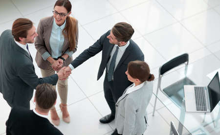 top view.handshake trading partners in the office Stock Photo