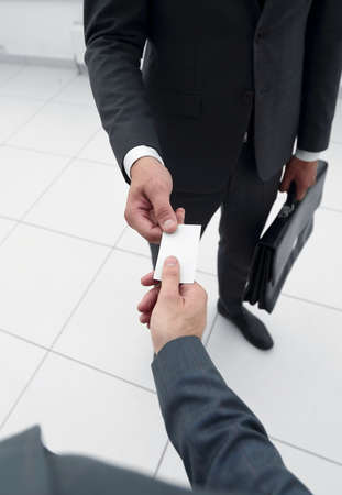 close up.the Manager gives the client his business card