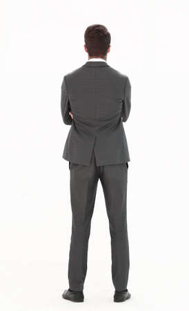 rear view. businessman looking at copy space
