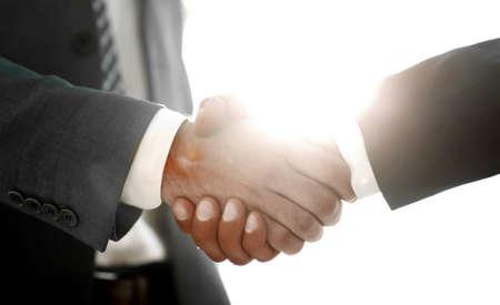 Businessman giving his hand for handshake to partner Фото со стока