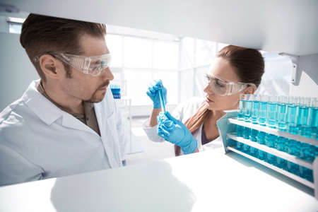 close up.two researchers work in the laboratory