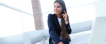 female Manager talking on mobile phone