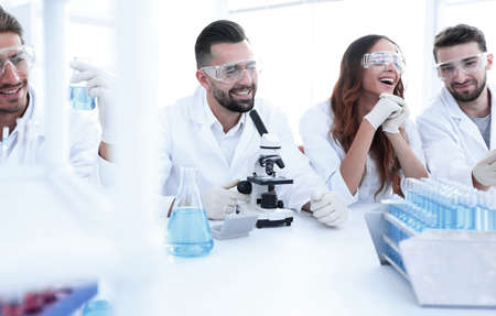 background image is a group of scientists microbiologists. Stok Fotoğraf