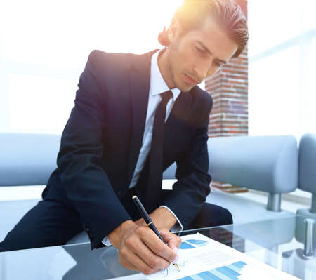 businessman working with a financial report. Stock Photo