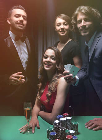 Upper class friends gambling in a casino. Banco de Imagens - 111442683