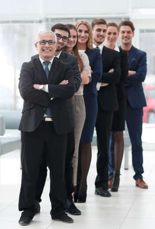professional team confidently look forward, standing in the middle of the office 版權商用圖片 - 111935071