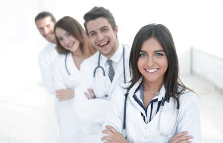 female doctor with group of happy successful colleagues Stock Photo