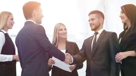 business team handshake and business partners