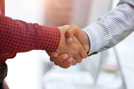 Closeup of a business hand shake between two colleagues Imagens